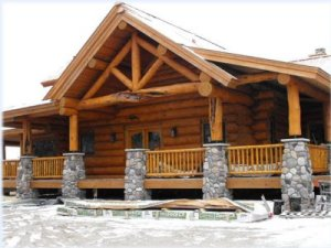 Staining and natural wood finishes on a custom log home
